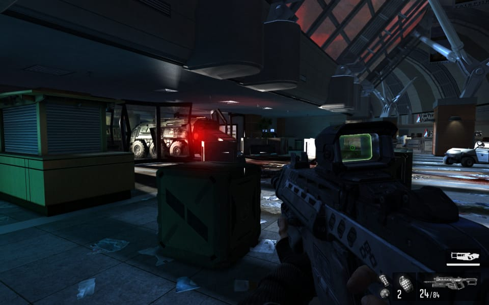 Screenshot from F.3.A.R., showing a armored truck crashed into the front doors of an airport