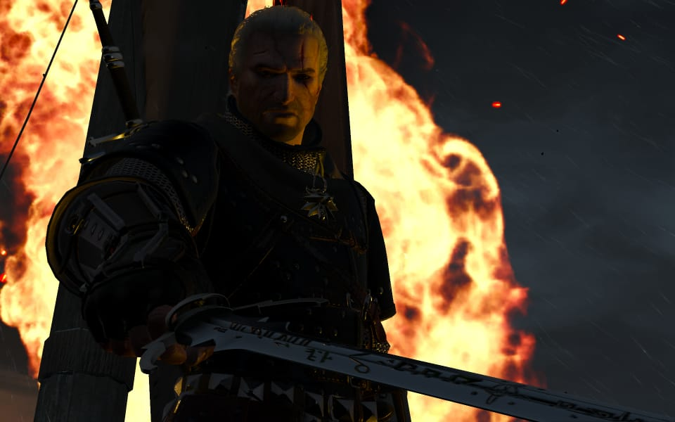 Screenshot of Geralt about to stick a sword into you.