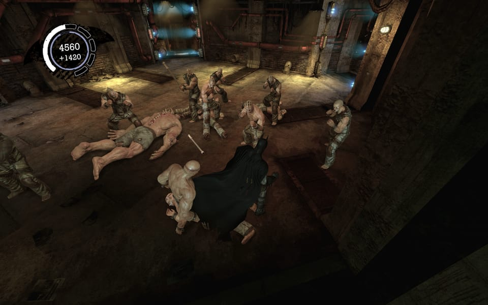 Screenshot of Batman punching a bunch of goons in Arkham Asylum.