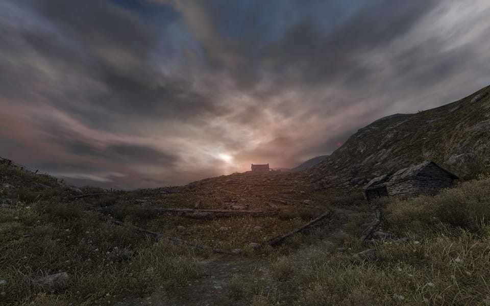 Screenshot from Dear Esther, showing a hillside covered with knee high stone walls.
